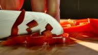 Cutting red bell pepper with knife video
