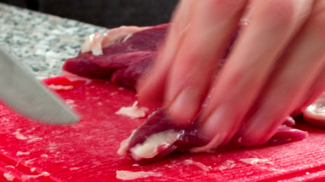 Cutting the meat into small pieces video