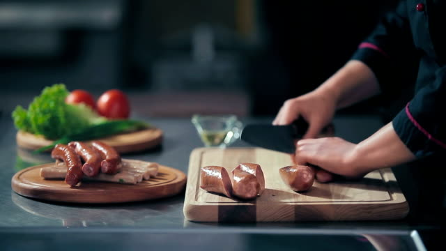 Cutting the sausages on a cutting board video