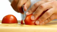 cutting tomato on wooden board video