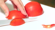 Cutting tomatoes close up. video
