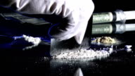 Cutting up drugs, cocaine video