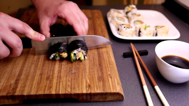 Cutting vegetarian futomaki sushi roll video