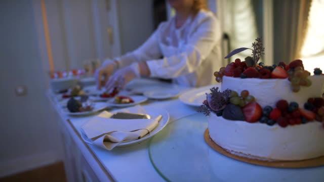 Cutting wedding cake video