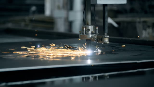 CNC LPG cutting with sparks close up metal manufacture technology steel material video