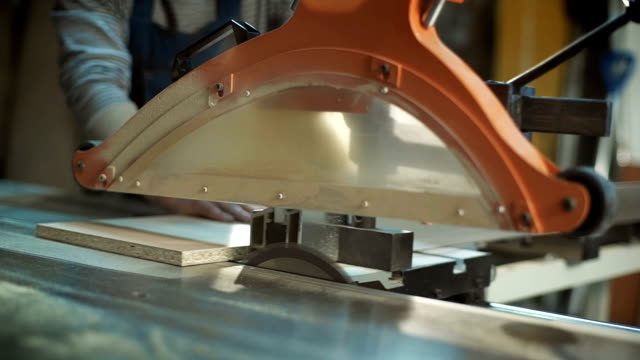 Cutting wood with sawing machine video