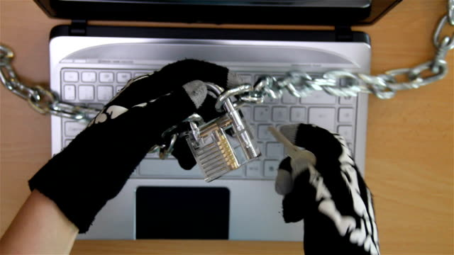 Cyber criminal stealing secrets with laptop video