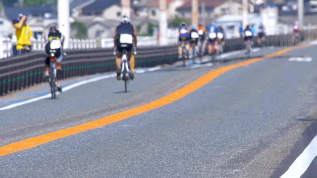 Cycle racing, bicycle race, triathlon race in back shot video