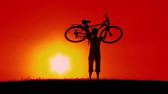 HD SLOW-MOTION: Cycler At Sunset video