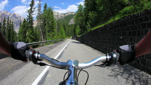 HD Cycling downhill a high mountain road video