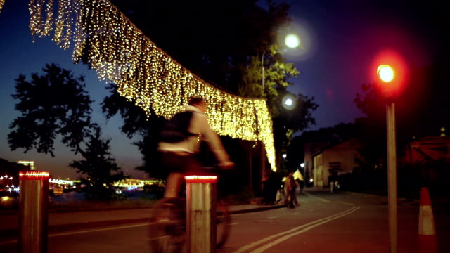 Cycling in a park at night video
