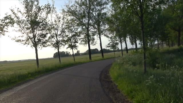 Cycling on a winding country road video