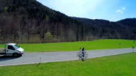 Cycling on electric bikes on the road through nature air view video