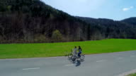 Cycling on electric bikes on the road through nature video