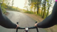 Cycling uphill in Tuscany on autumn season. POV video