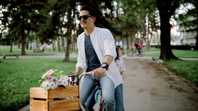 Cyclist and his girlfriend enjoy in spring ride video