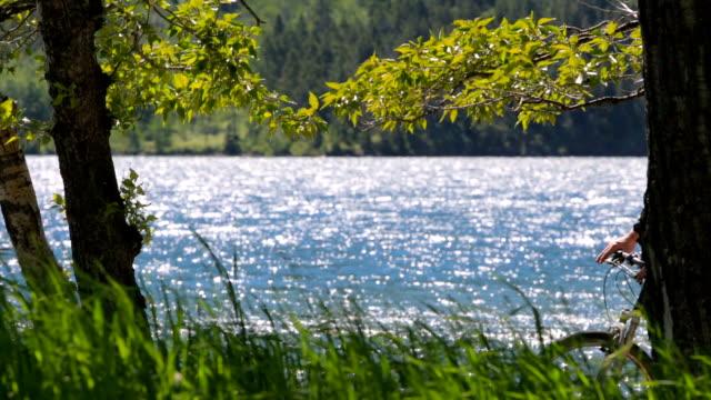 Cyclist Enjoys Lakeside View video