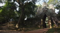 Cyclist Going Through Angkor Thom Gate, Siem Reap, Cambodia video