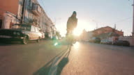 Cyclist man riding fixed gear sport bike in sunny day on a city at sunset video