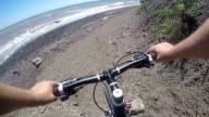 Cyclist point of view cycling man falling head first off his bike during ride down the hill video