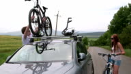 Cyclists traveling with two bikes on the roof of car video