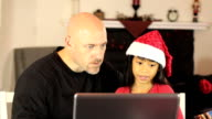 Dad And Daughter Shop Online For Christmas Gifts video