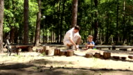 Dad and son play in the sandbox video