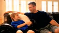 Dad and Son Talking look at Camera video