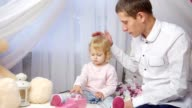 Dad playing with his little daughter, father and child at home video