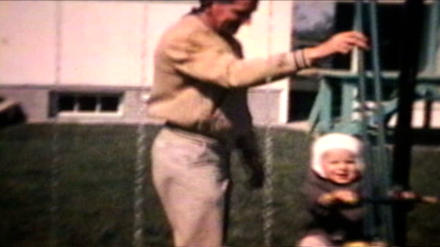 Dad Pushes Little Boy On Swing (1963 - Vintage 8mm) video