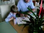 Dad Teaching Child to Write video