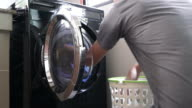 Daily chores: Man laundry at home video