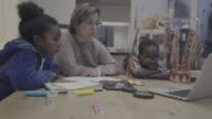 daily life of a child: homework at home with mother video