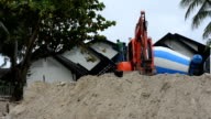 PHUKET, THAILAND JUNE - 15 : Dam construction with Backhoe along the beach to reduce the waves at kata beach on June 15, 2016. video