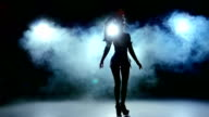 Dance of beautiful sexy girl in erotic black suit clothes, smoke, slow motion video