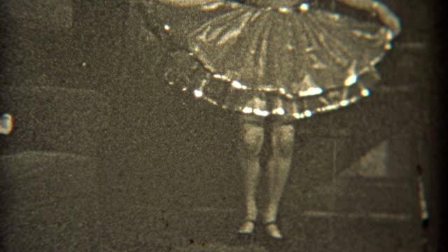 1936: Dancer practicing her craft indoors with fancy dress. video