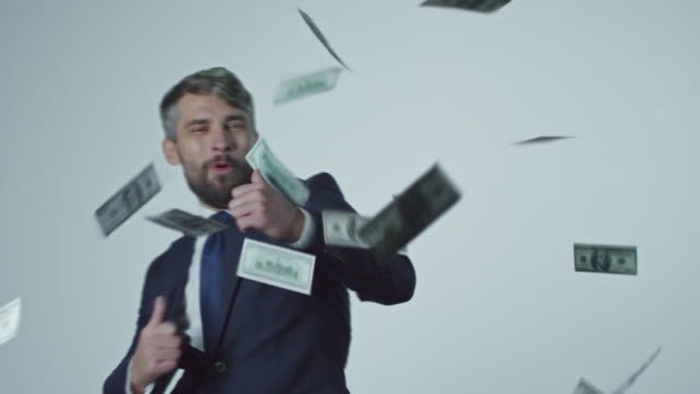 Dancing Businessman Surrounded by Falling Money video