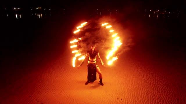 Dancing fire show on the sandbanks beach at sunset video