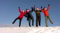 dancing friends with christmas hats on snow video