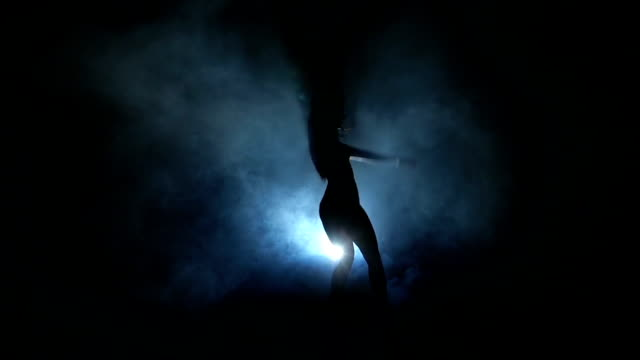 Dancing silhouettes of woman in a nightclub. Slow motion. video