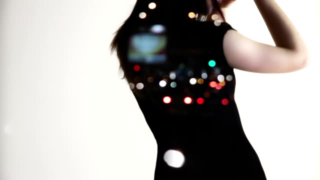 dancing woman on white background and with city lights on her body video