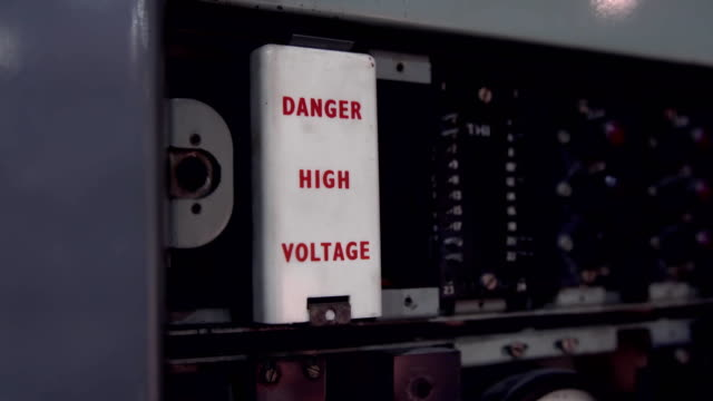 Danger high voltage sign. Old telephone dial station video