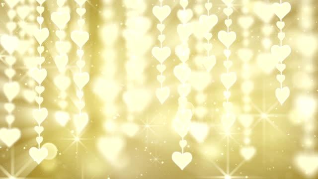 dangling gold hearts loop video