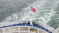 Danish flag fluttering in the wind on the ship video