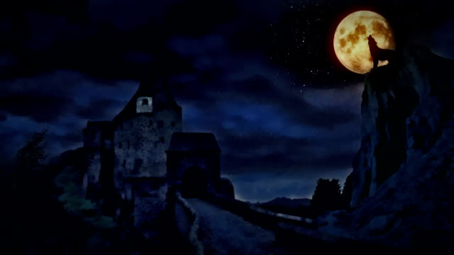 Dark castle and a wolf howling at the moon. video