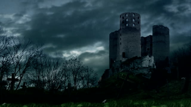 Dark castle and cemetery during storm. video