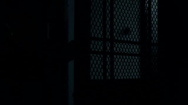 Dark figure holding knife, killer sneaking the house, violence video
