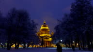 Dark frozen park and Isaakievskiy Sobor at winter night, time lapse video
