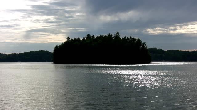 Dark island w/sparkling lake. video