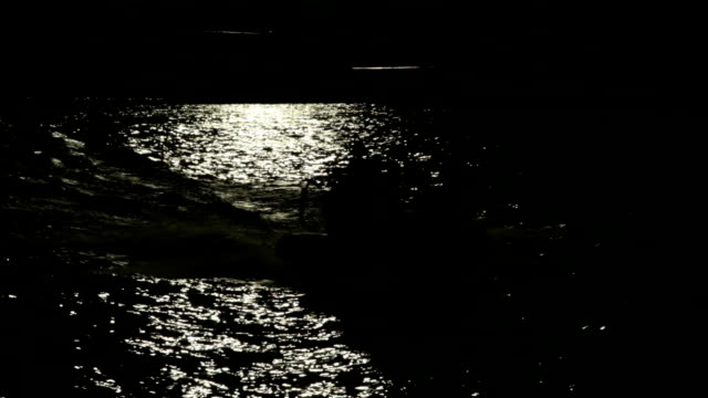Dark, mystical River with boat passing by. video